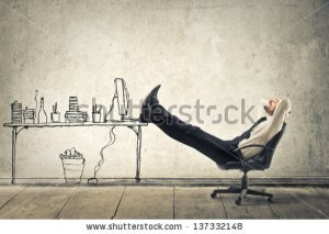 stock-photo-young-businessman-relaxes-sitting-in-the-office-137332148
