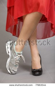 stock-photo-crossed-legs-of-a-beautiful-woman-wearing-and-evening-gown-with-one-running-shoe-and-one-dress-shoe-77963044