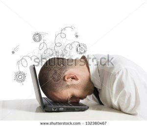 stock-photo-concept-of-stress-with-businessman-sleeping-on-a-laptop-132360467